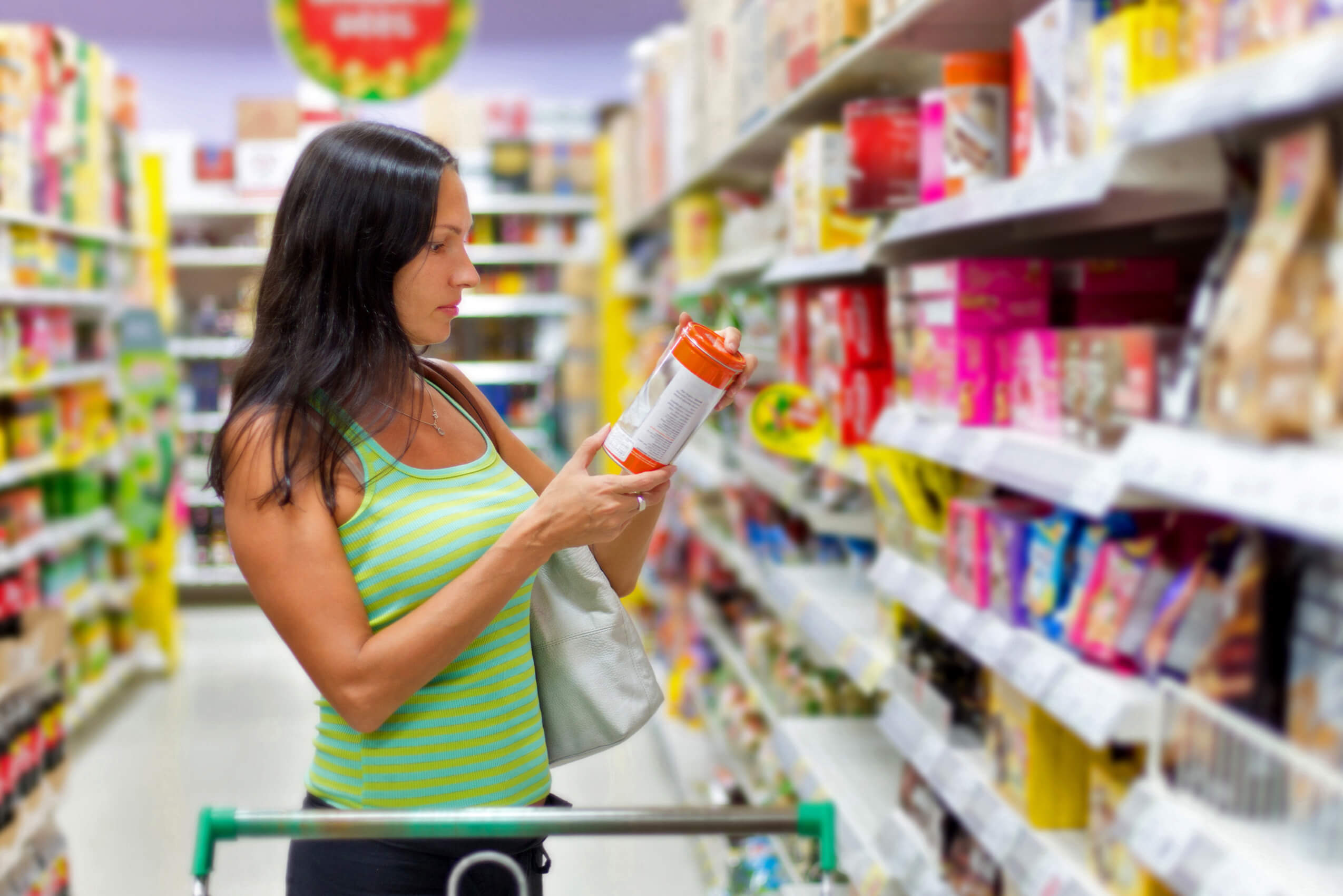 woman-reads-a-products-label-checking-for-harsh-chemicals
