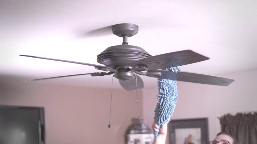 Dusting-a-ceiling-fan-top-to-bottom-house-keeping-spring-cleaning
