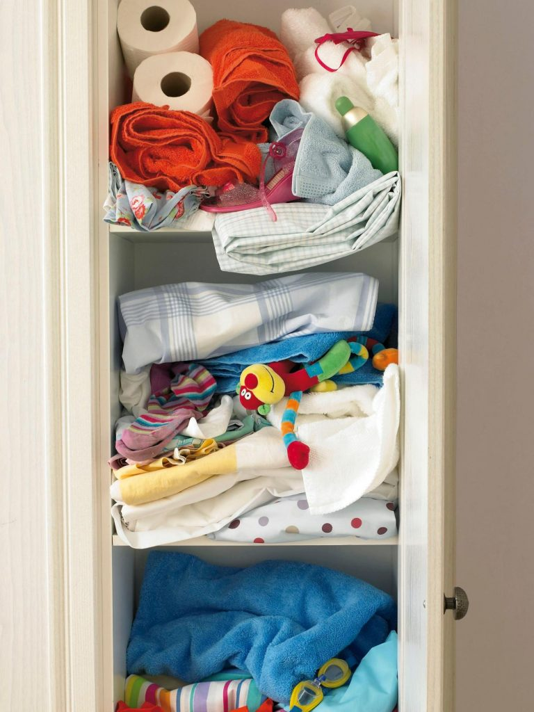 An-over-packed-flooded-messy-linen-closet